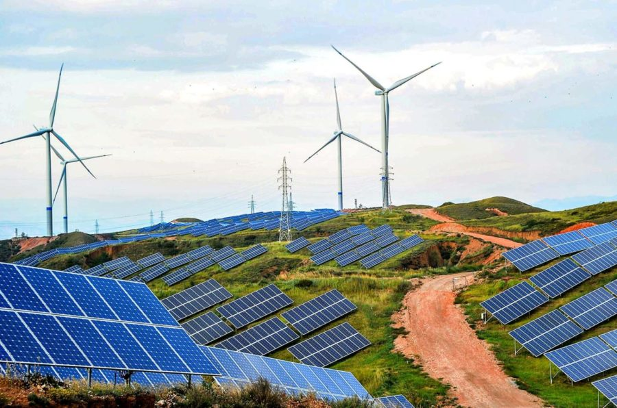 ZHANGJIAKOU, CHINA - JULY 02: Solar panels and wind turbines are pictured on a barren mountain at Shenjing Village on July 2, 2018 in Zhangjiakou, Hebei Province of China. The installed capacity of renewable energy electricity generation in Zhangjiakou has reached 12.03 million kilowatts. (Photo by VCG)
